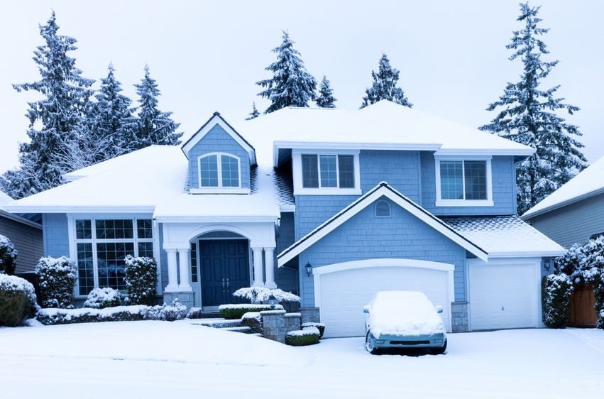 a house sits in the snow during winter | plumbing and hvac in colorado springs
