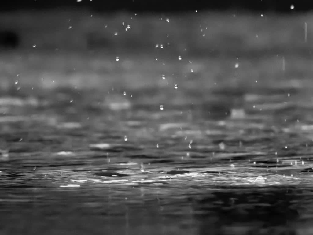 rain falls into a puddle | plumbing colorado springs