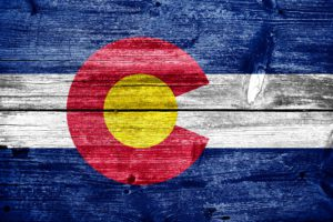 colorado state flag on wood boards | plumbing & HVAC woodland park