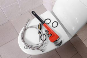 Plumber's tools on toilet at colorado springs home | colorado springs plumber