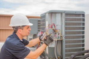 a technician works on a heat pump repair in colorado springs