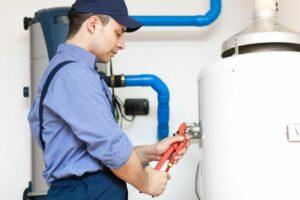 a plumber working on boiler repair in colorado springs