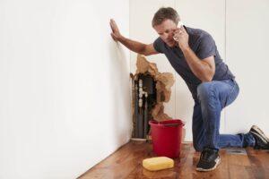 a man in need of an emergency plumber in colorado springs