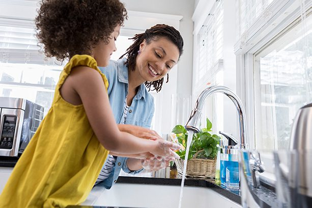 mother and daughter using sink after they get plumbing repair in colorado springs